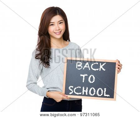 Asian woman hold with black board and showing phrase of back to school