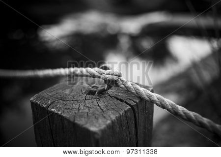 Knot From The Rope On A Wooden Column On Pierce