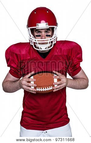 Portrait of an american football player holding a ball