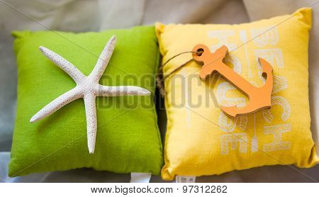 Holiday Summertime Travel Concept - Small Toy Pillows With Starfish And Anchor