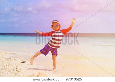 little boy having fun on tropical beach