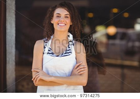 Portrait of a waitress with arms crossed at the coffee shop
