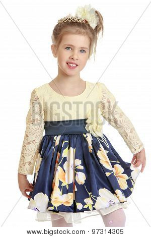 Fashionable little girl in a beautiful dress