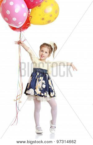 Fashionable little girl with balloons