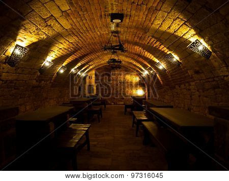 Dark wine cellar with tables