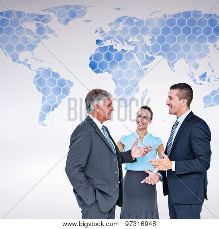 Business people standing and talking against background with world map