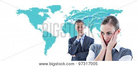 Business team thinking against world map