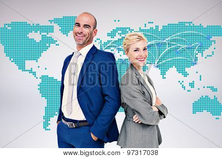 Smiling business people back-to-back against world map