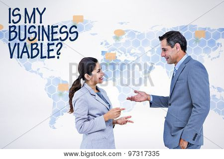 Confident business people smiling against world map