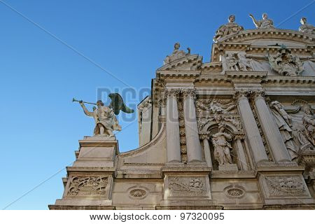 VENICE, ITALY - SEPTEMBER 2014 : A Detail of an Angel with a trumpet at the facade of Santa Maria del Giglio church (Santa Maria Zobenigo) in Venice, Italy on September 14, 2014.