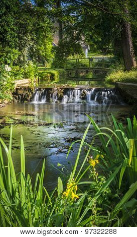 Small Waterfall In The Village Of Glympton