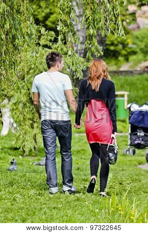 Couple strolling through the park