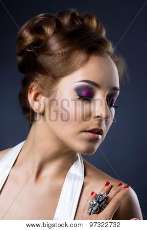 beautiful woman with red hair against dark studio background