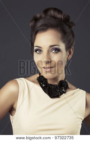 beautiful elegant woman with classic look against dark studio background