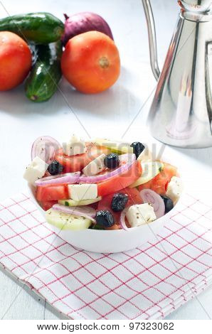 Greek salad with feta cheese tomatoes cucumbers and black olives