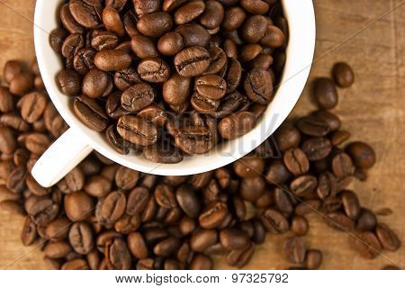 Coffee Cup Filled With Coffee Beans.