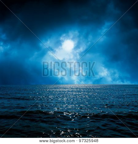moon light in dramatic sky over dark sea