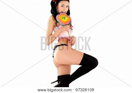 Erotic smiling woman in bikini with big candy lollipop