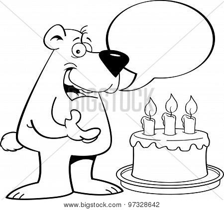Cartoon bear with a speech balloon and a birthday cake.