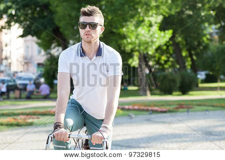 Stylish Guy Holding Vintage Race Bike