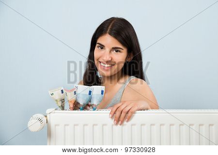 Woman With Banknote Inside Radiator