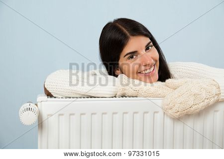 Woman In Sweater Leaning On Radiator
