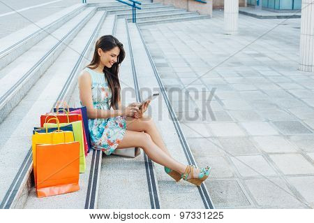 Young Woman Buying Online Through A Digital Tablet