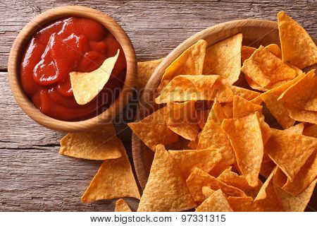Nachos Corn Chips With Spicy Sauce Close-up. Horizontal Top View