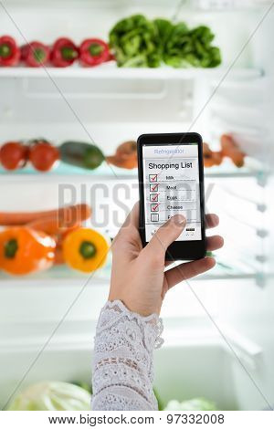 Person Hand With Mobile Phone Showing Shopping List