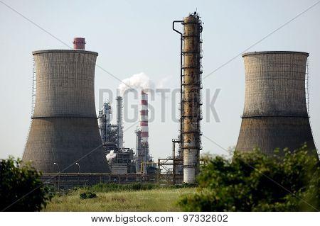 Petrochemical Plant Seen Through Green Bushes