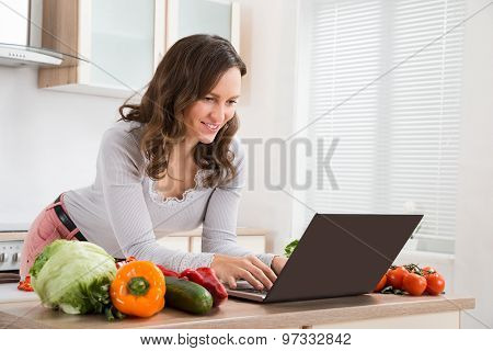 Woman Looking Recipe On Laptop