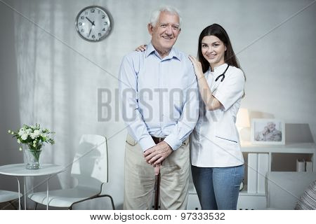 Senior Man And Caring Doctor