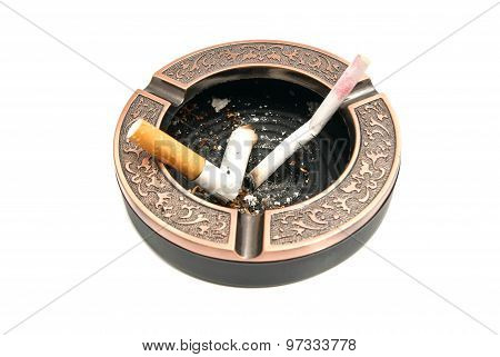 Cigarette Butts In Metal Ashtray