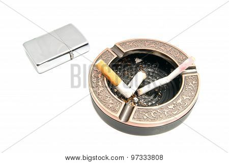 Cigarette Butts In Ashtray And Metal Lighter