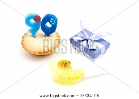 Cupcake With Ninety Years Birthday Candle, Gift And Whistle On White
