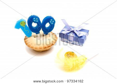 Cupcake With One Hundred Years Birthday Candle, Whistle And Gift On White