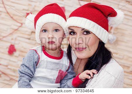 Mother Holding A Toddler Santa