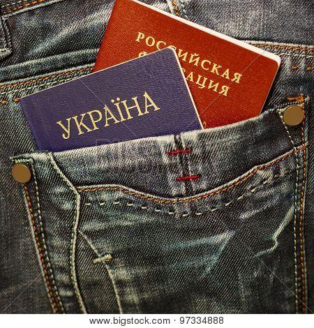 Ukrainian And Russian Passport In Jeans Pocket
