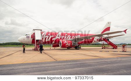 LOEI, THAILAND - JULY 15, 2015: AirAsia Jet airplane in Loei airport in Loei. Its been named as world's best low-cost airline, operates scheduled flights to 78 destinations