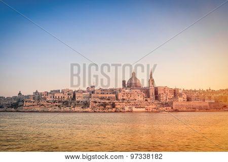 La Valletta At Sunset From The Sea - Capital Of World Famous Mediterranean Island Of Malta