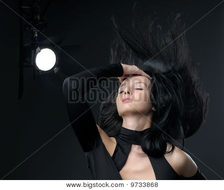 Face Shot Of Brunette Girl With Hair Blowing
