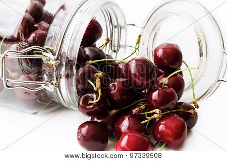 Berries ripe cherry in glass jar