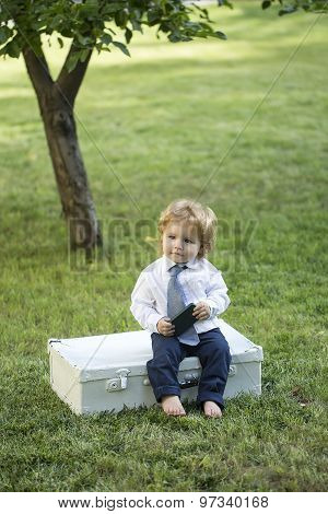 Male Child With Vintage Briefcase