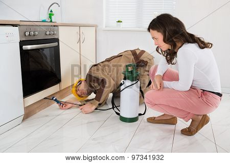 Woman And Worker With Pesticide Sprayer