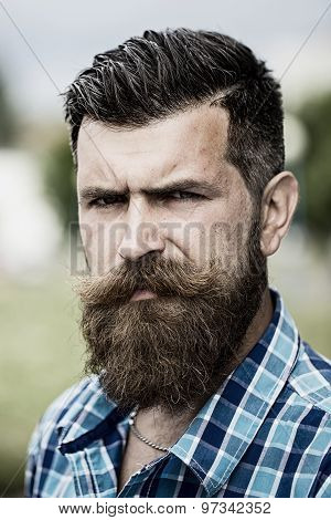 Portrait Of Serious Man Outdoor