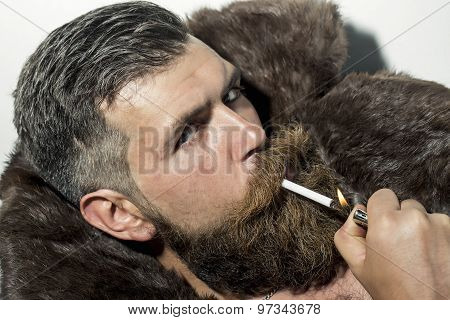 Sexual Man In Fur Coat Smoking