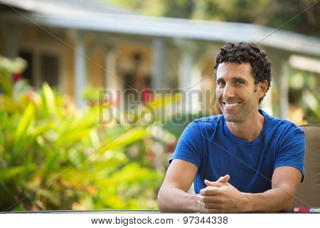 Cheerful Man With Folded Hands
