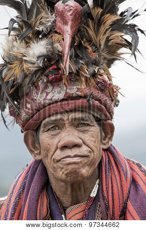 old ifugao man in national dress next to rice terraces. Ifugao