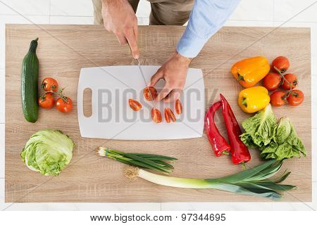 Male Hands Chopping Vegetables