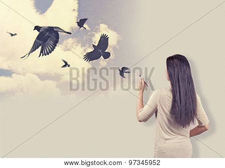 Girl painting birds, dream concept